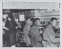 Description: Ronald Martin, Robert Patterson, and Mark Martin stage sit-down strike after being...